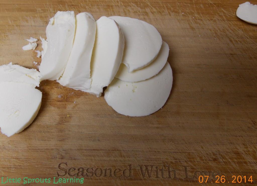 Slice up some fresh mozzarella as thin as you can.
