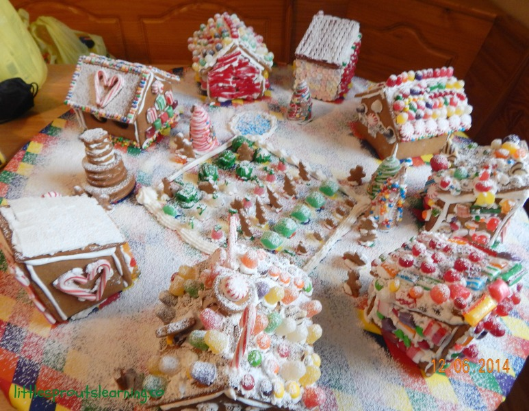 completed gingerbread creation with snow gingerbread party with kids