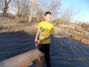 Kids building raised garden beds