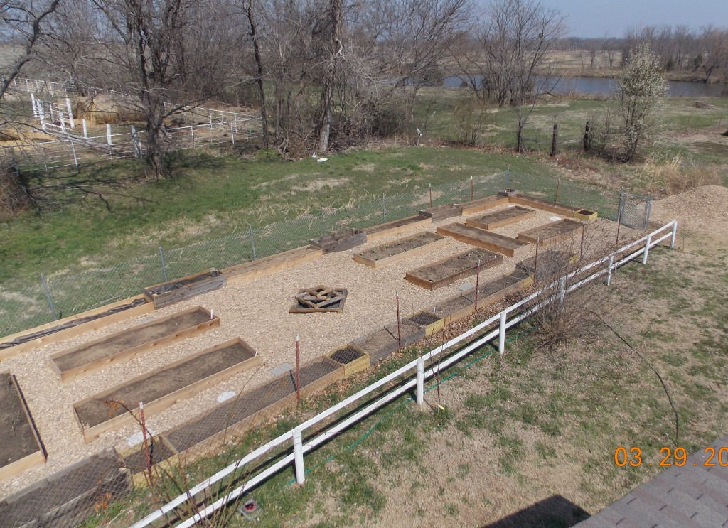 aerial view of the children's garden daycare garden raised beds, empty, just filled with soil.