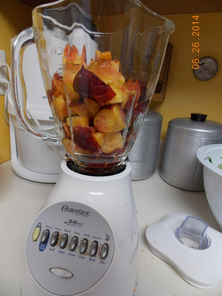peaches in the blender for making peach yogurt pops
