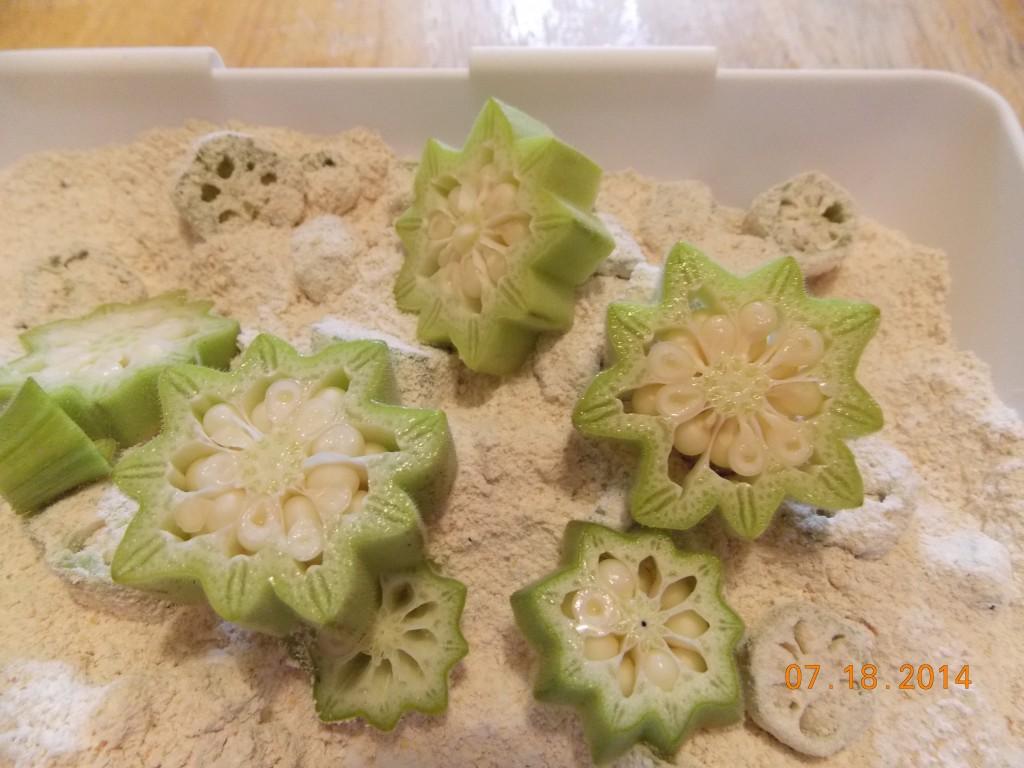 sliced okra on a bed of flour