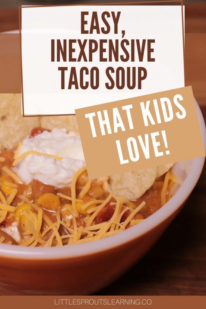 bowl of taco soup topped with cheese, sour cream, and chips