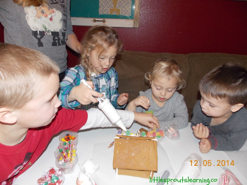 children creating gingerbread