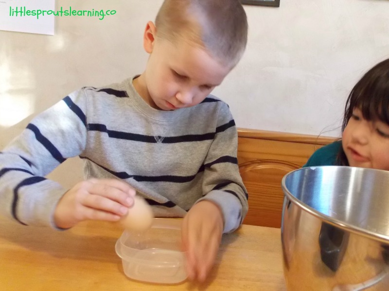 Banana-Rama Bread-Cooking with Kids, child cracking egg on side of bowl.