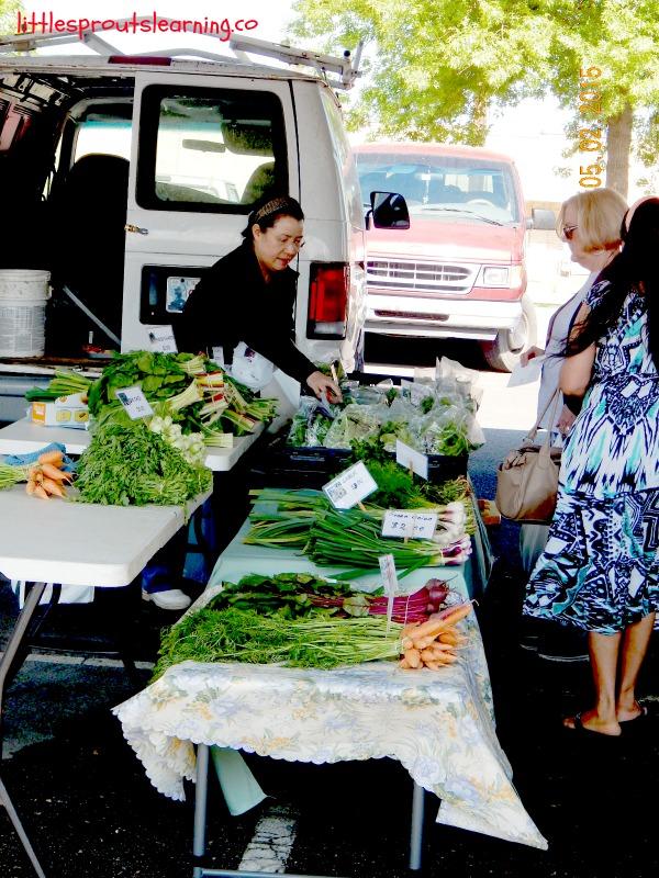 garden tour farmer's market, booth full of vegetables