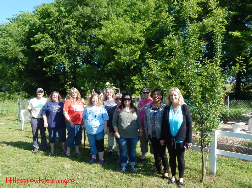 Childcare providers touring children's gardens