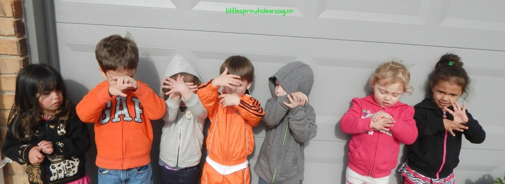 butterfly heroes pose, 7 young preschoolers