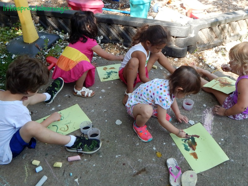 watercolors over glue, relief paint for preschool, kids on the porch paining with watercolors at their kids art party