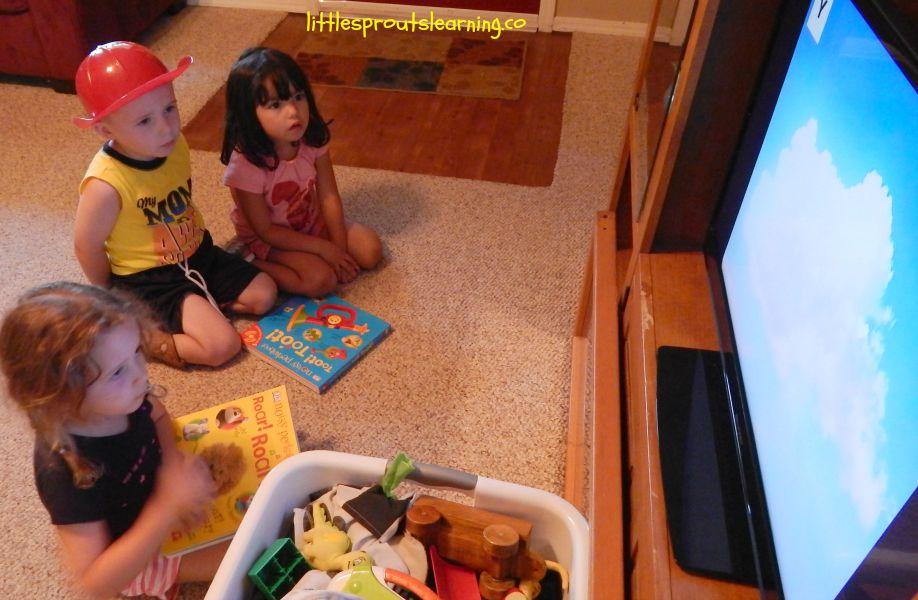 screen time and kids, three kids sitting around the tv watching.