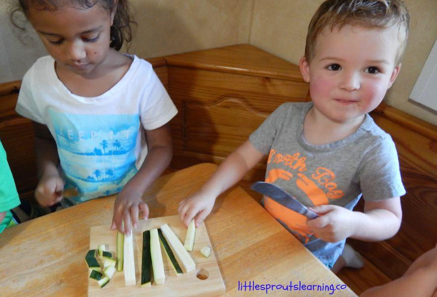 kids cutting garden vegetables