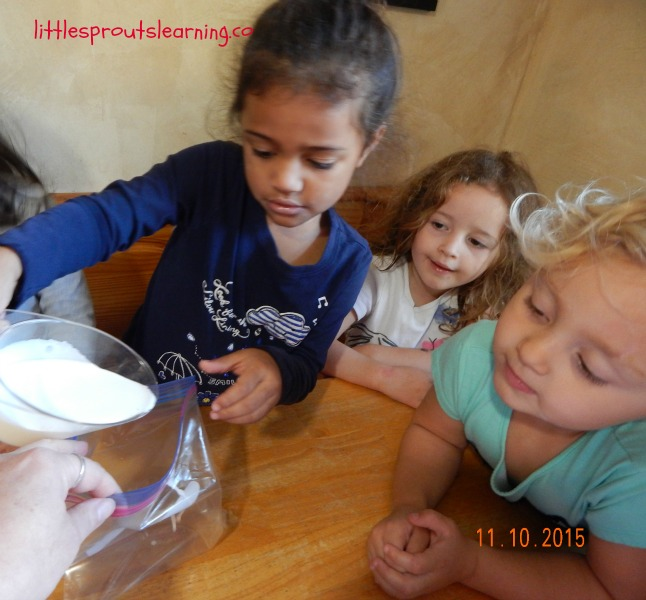 kids putting cream in a bag for ice cream in a bag