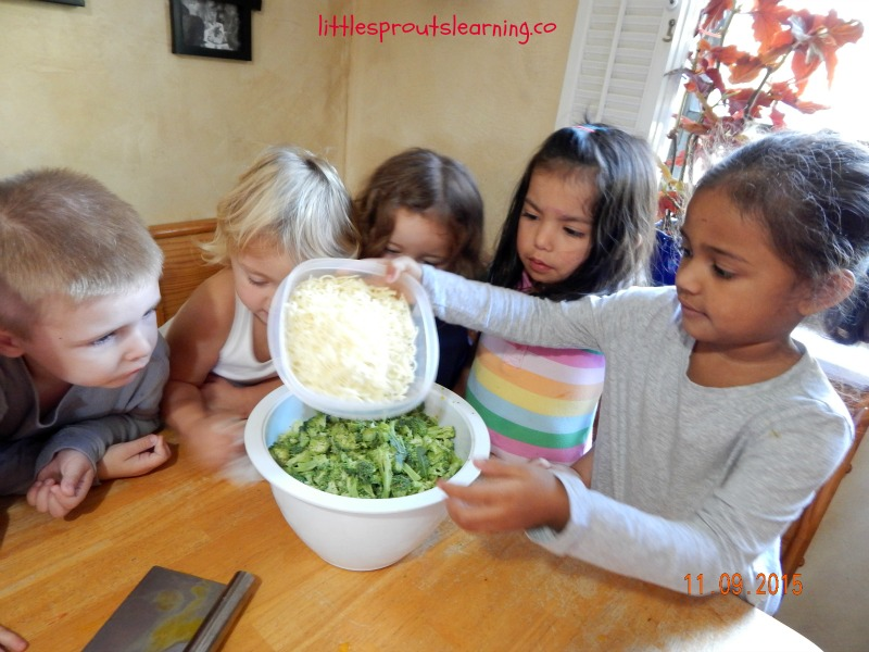 kids cooking egg and veggie casserole