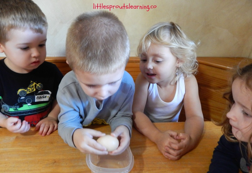 kids cracking eggs