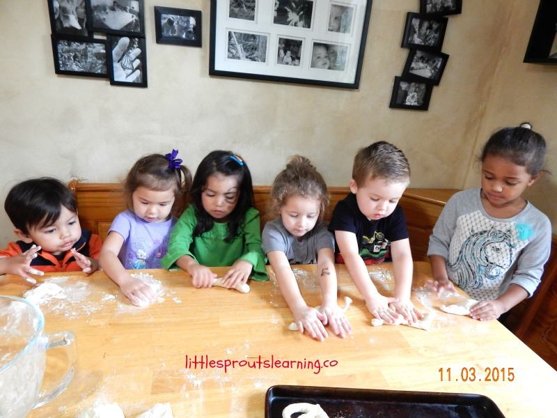 kids rolling homemade pretzles