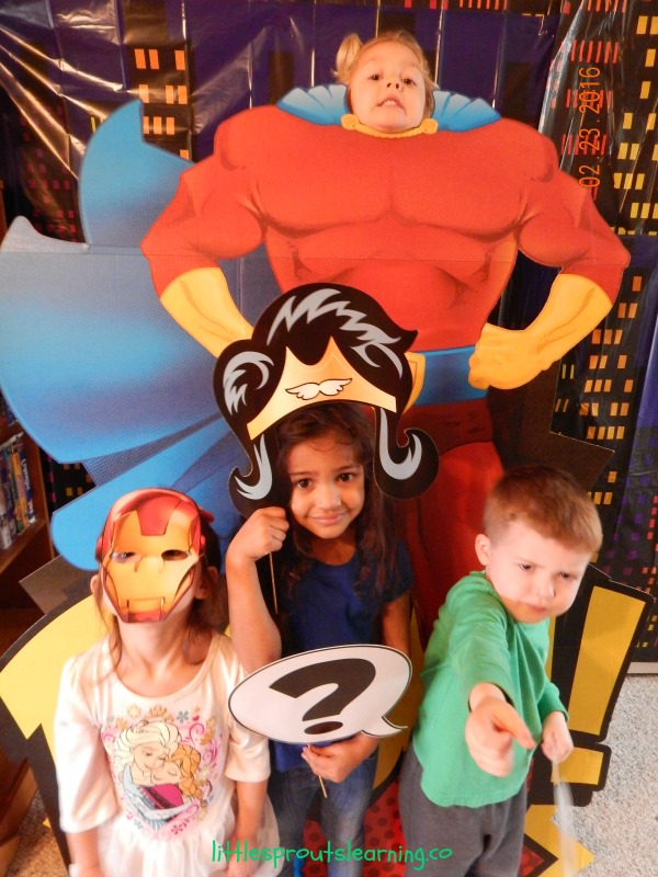 More Than JUST a Provider, kids in superhero photo props