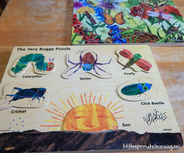 puzzle gifts for daycare kids on the table. Wooden bug puzzles