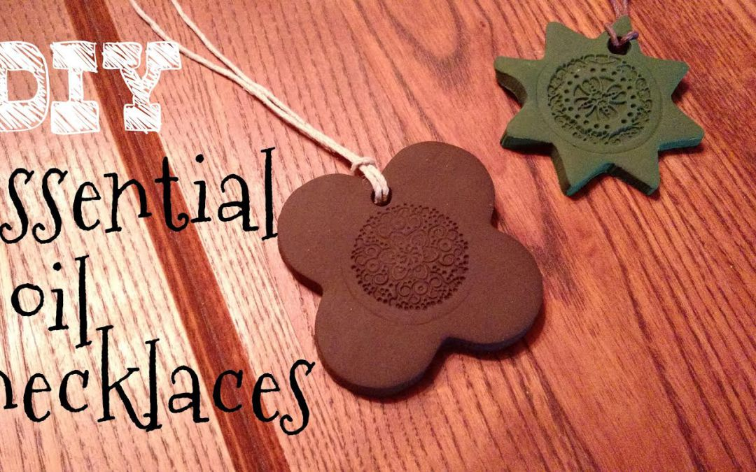 essential oil necklaces to give as gifts laying on a table