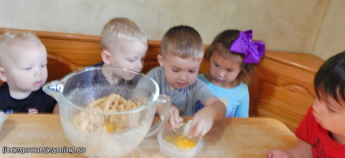 kids-cracking-eggs-for-making-cookies-cooking-with-kids