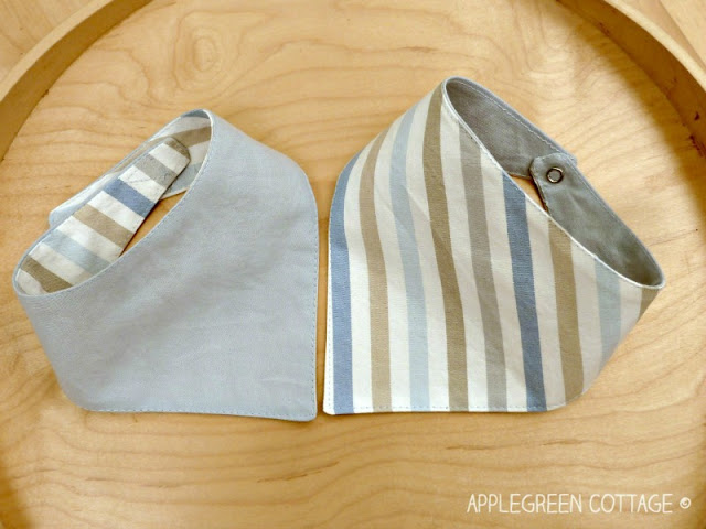 bandana bibs, hand sewn for gifts, on a tray
