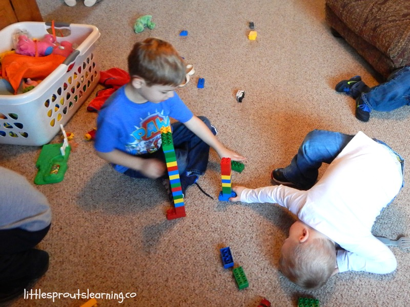 daycare kids sharing toys