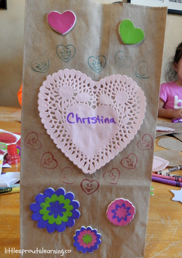 valentine paper sack decorated with doilies and stickers
