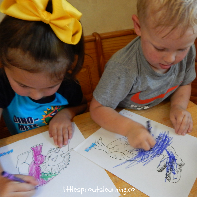 kids at the table coloring dinosaur color sheets