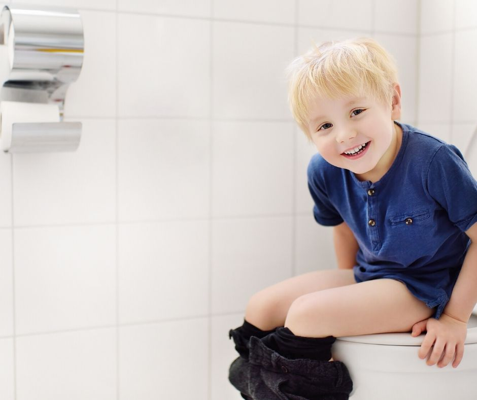 child sitting on the big potty learning to use it