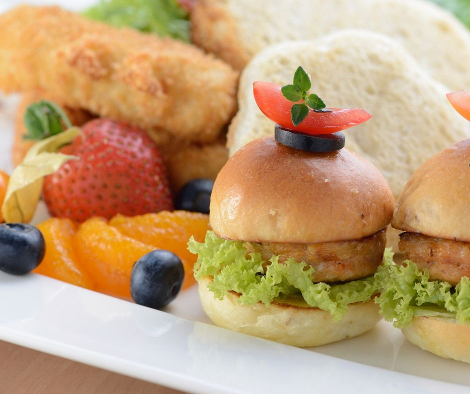 sliders on a plate with fruit for meals for kids
