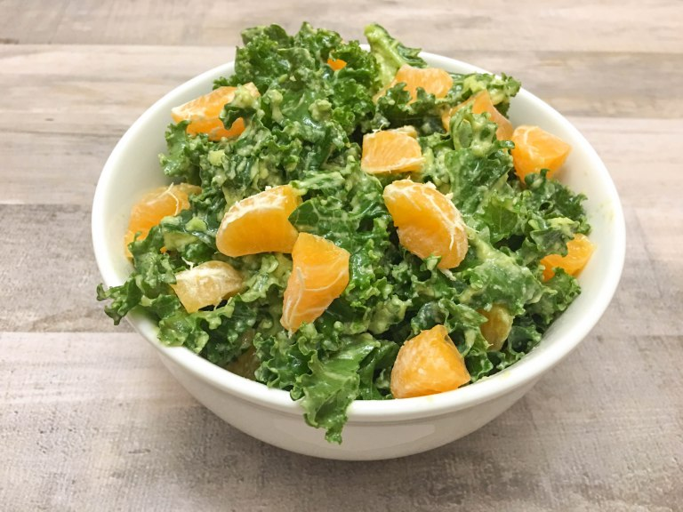 kale and citrus salad in a bowl for meatless dinner