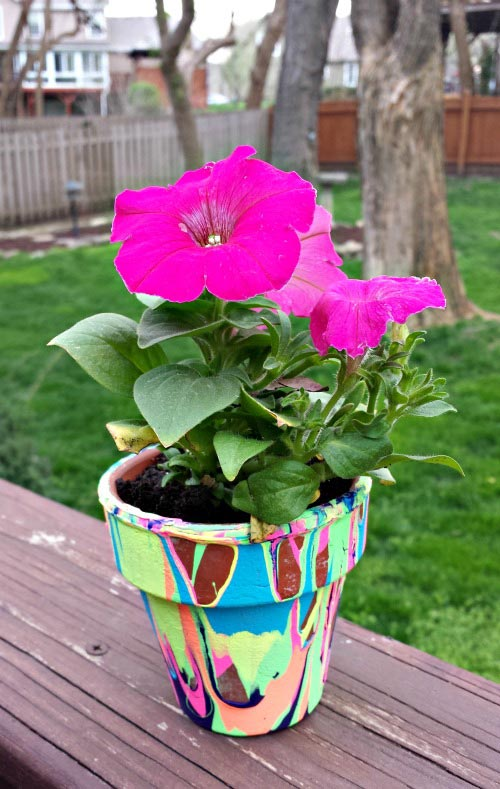 color painted drip paint flower pot with pink flower