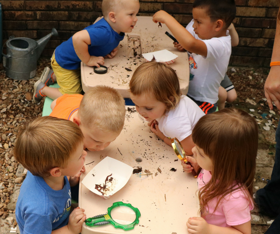 kids observing worms for composting