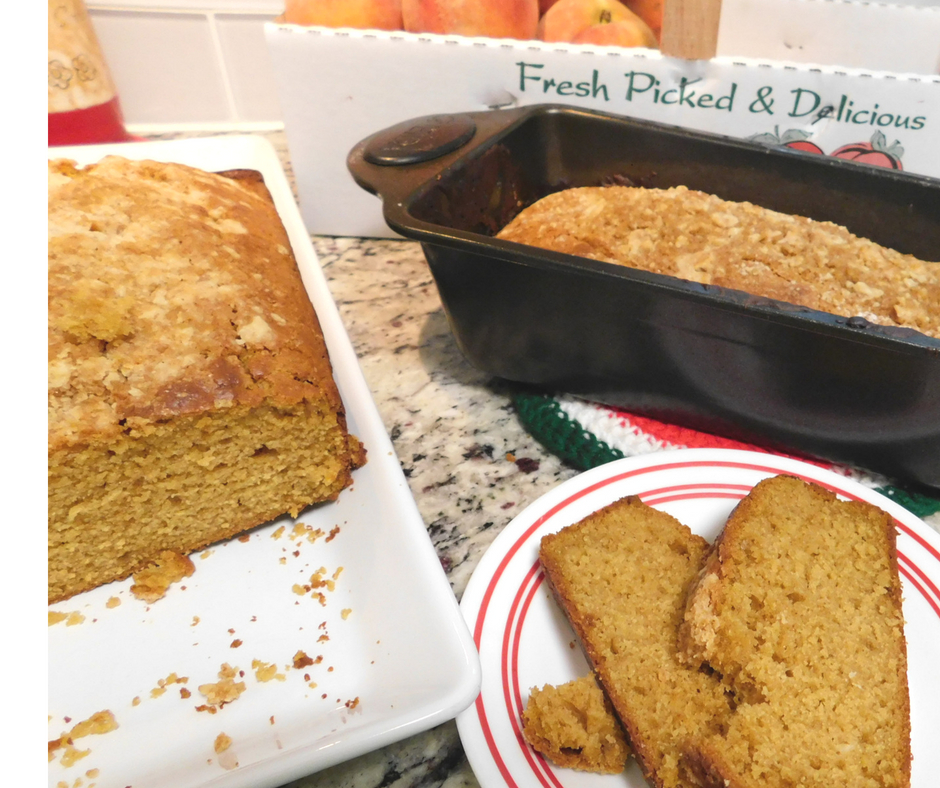 peach pumpkin cobbler bread on a plate with loaf next to it, peaches
