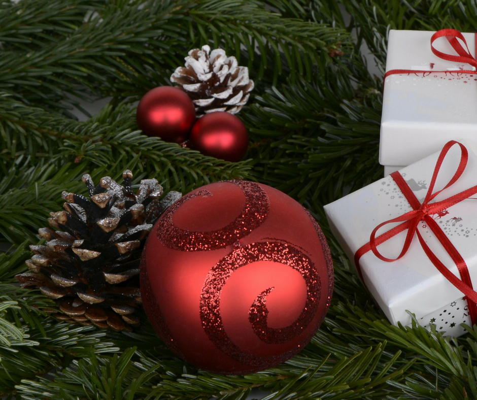 Greenery with small wrapped gifts, pinecones and christmas ornament balls