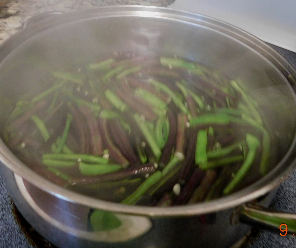 green beans blanching in a pot on tht stove