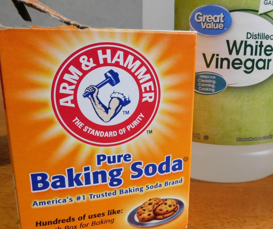 Baking soda and vinegar sitting on table