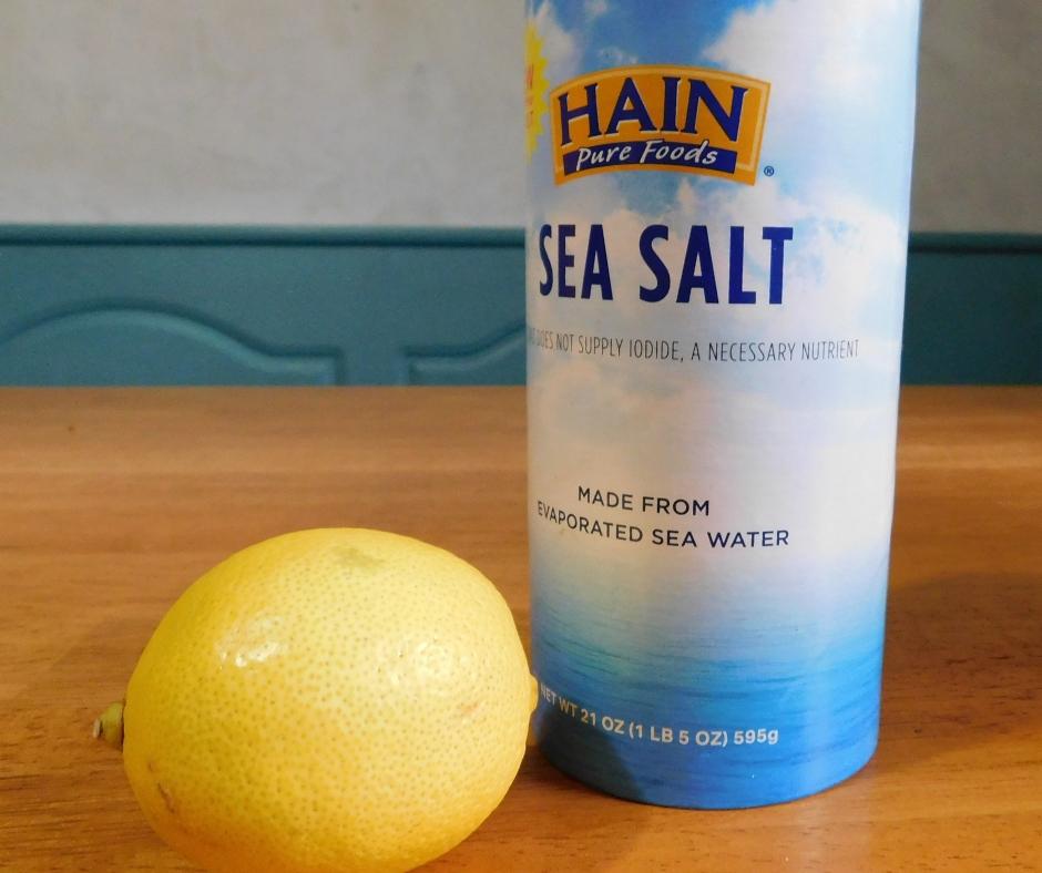 salt and a lemon sitting on table