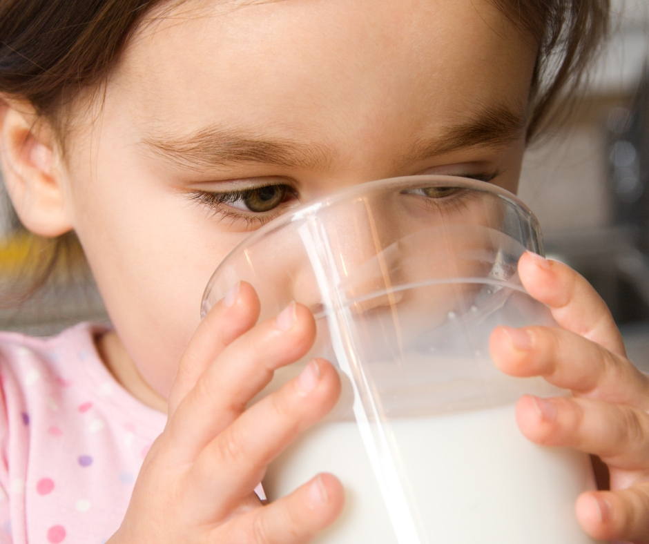 eco-healthy home based child care, child drinking milk from a class