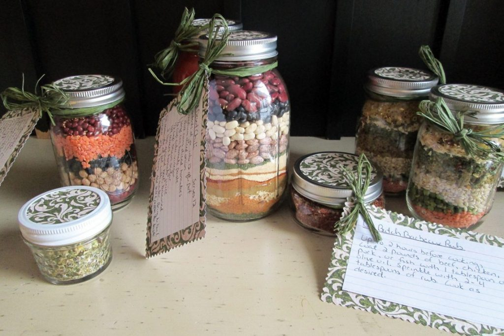 table full of homemade mason jar gifts, soup mixes, spice mixes, etc.