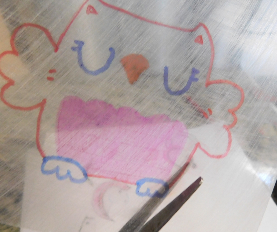 cutting out diy shrinky dink owl