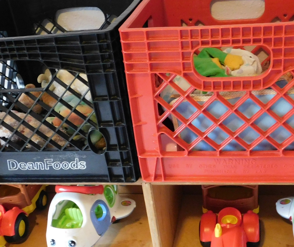 milk crates full of daycare toys on toy shelf, how to organize toys for daycare