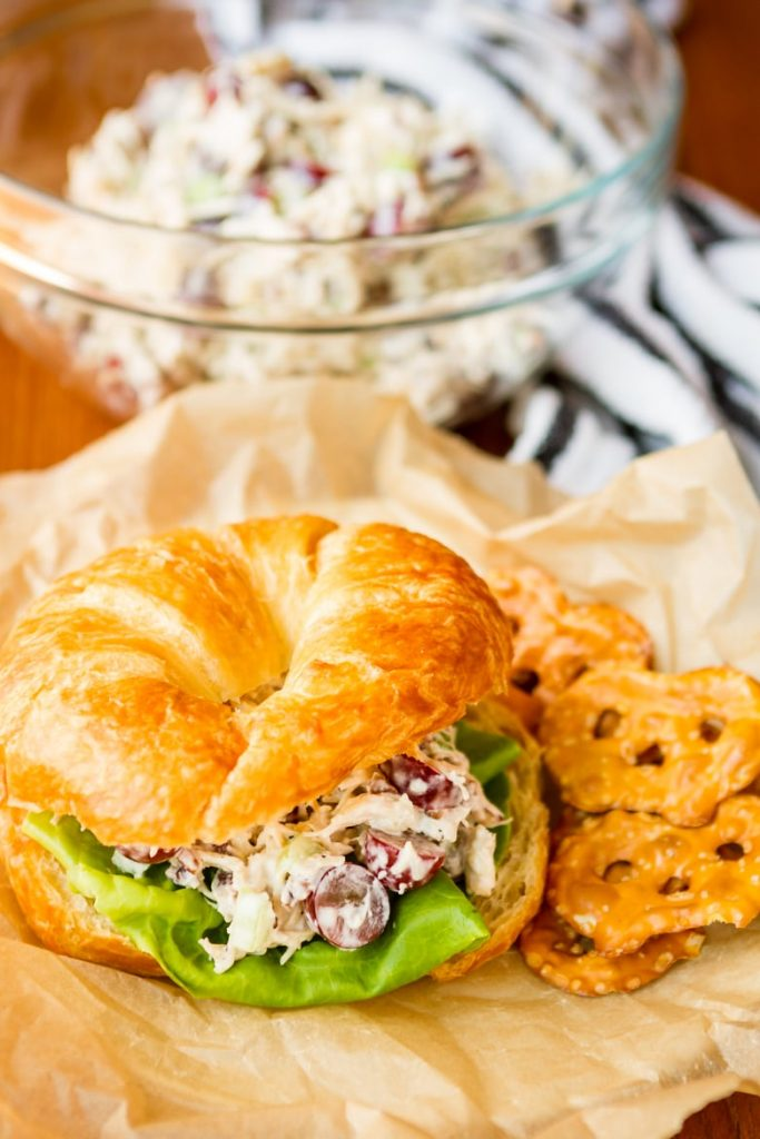 Chicken salad sandwich on a plate with pretzels