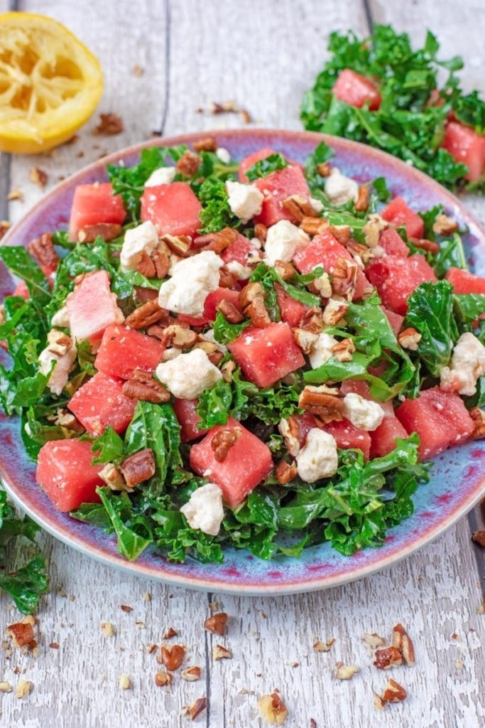 bowl of kale and watermelon salad on a table.
