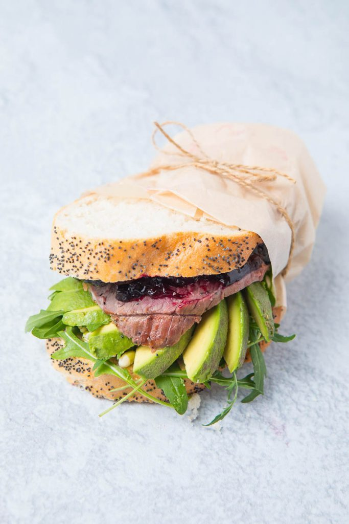 lamb and avocado sandwich wrapped in paper