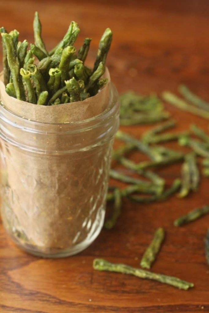 Green bean crisps in a small mason jar