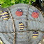 Looking to make the most of your summer? Check out this wooden tic tac toe game and other garden games you can make with what you have around the garden.