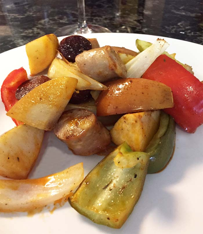 Sausage apples and peppers on a plate