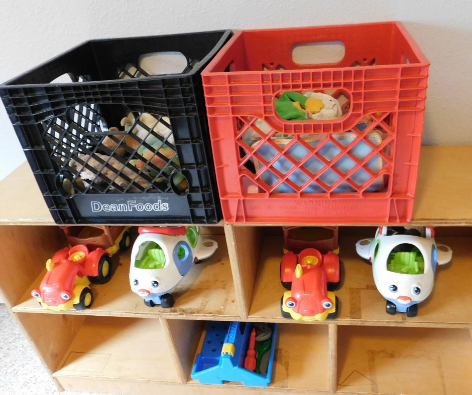 toy shelves with toy baskets and large push toys managing daycare supplies
