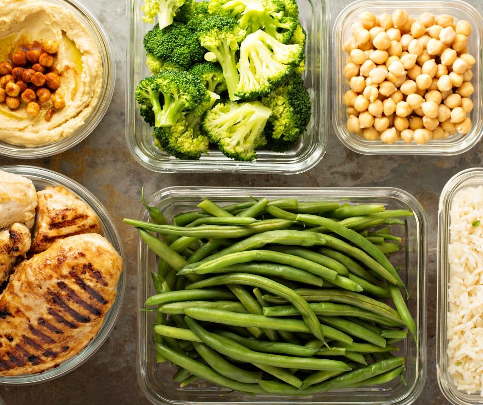 Meal prep containers with veggies, beans and more