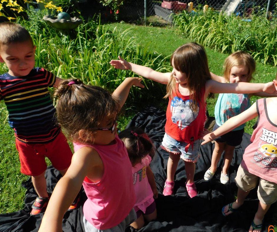 kids in the garden doing yoga